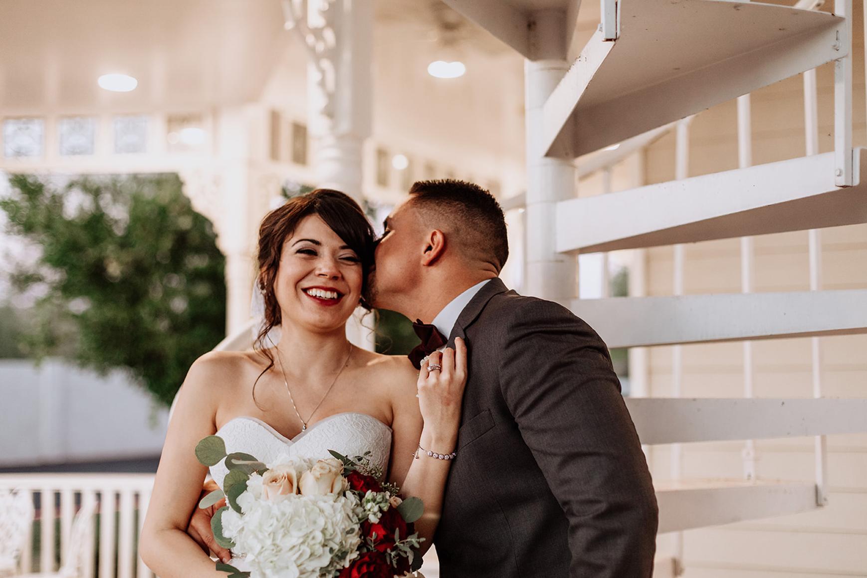 Groom kissing bride's cheek - Lindsay Grove - Mesa, Arizona - Maricopa County - Wedgewood Weddings