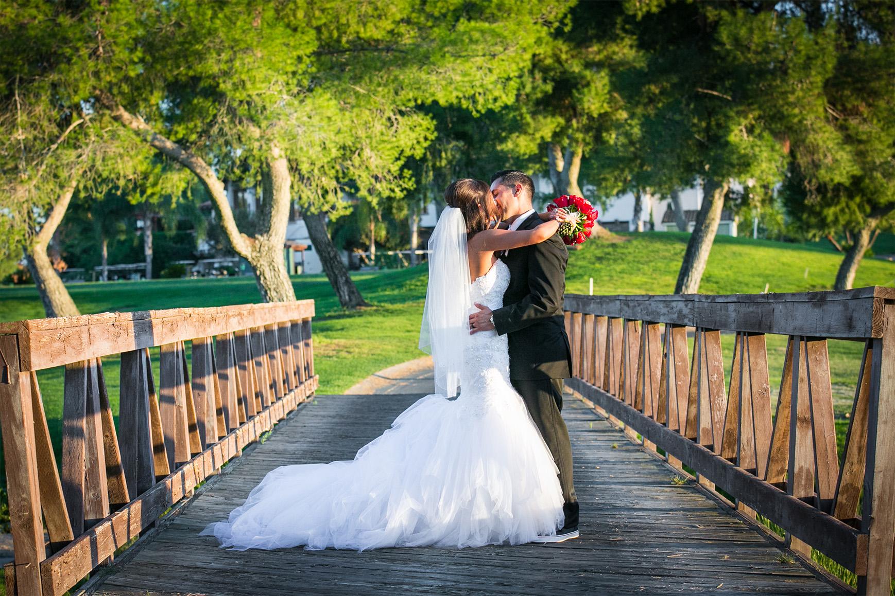 Kiss on the bridge - Menifee Lakes - Menifee, California - Riverside County - Wedgewood Weddings
