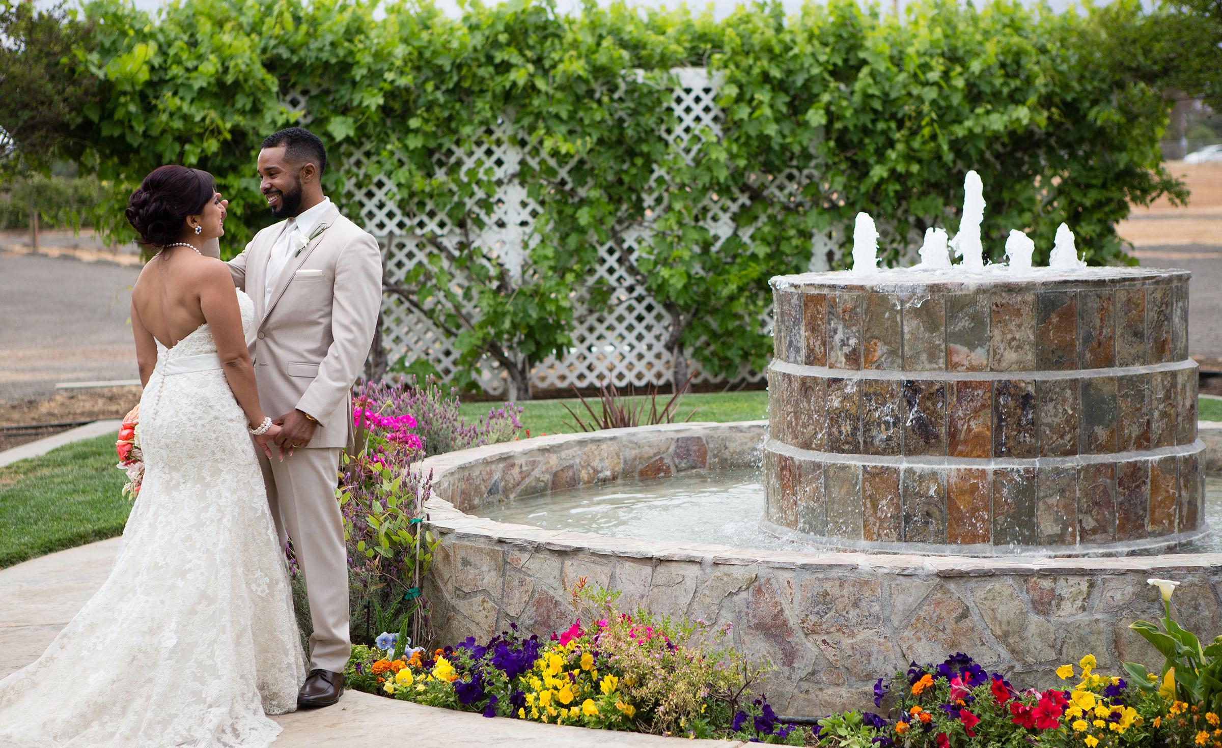 Newlyweds by fountain
