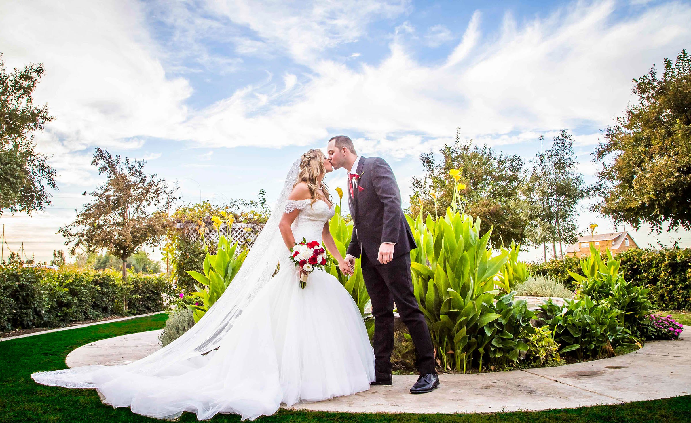 Garden kiss  - Orchard - Menifee, California - Riverside County - Wedgewood Weddings