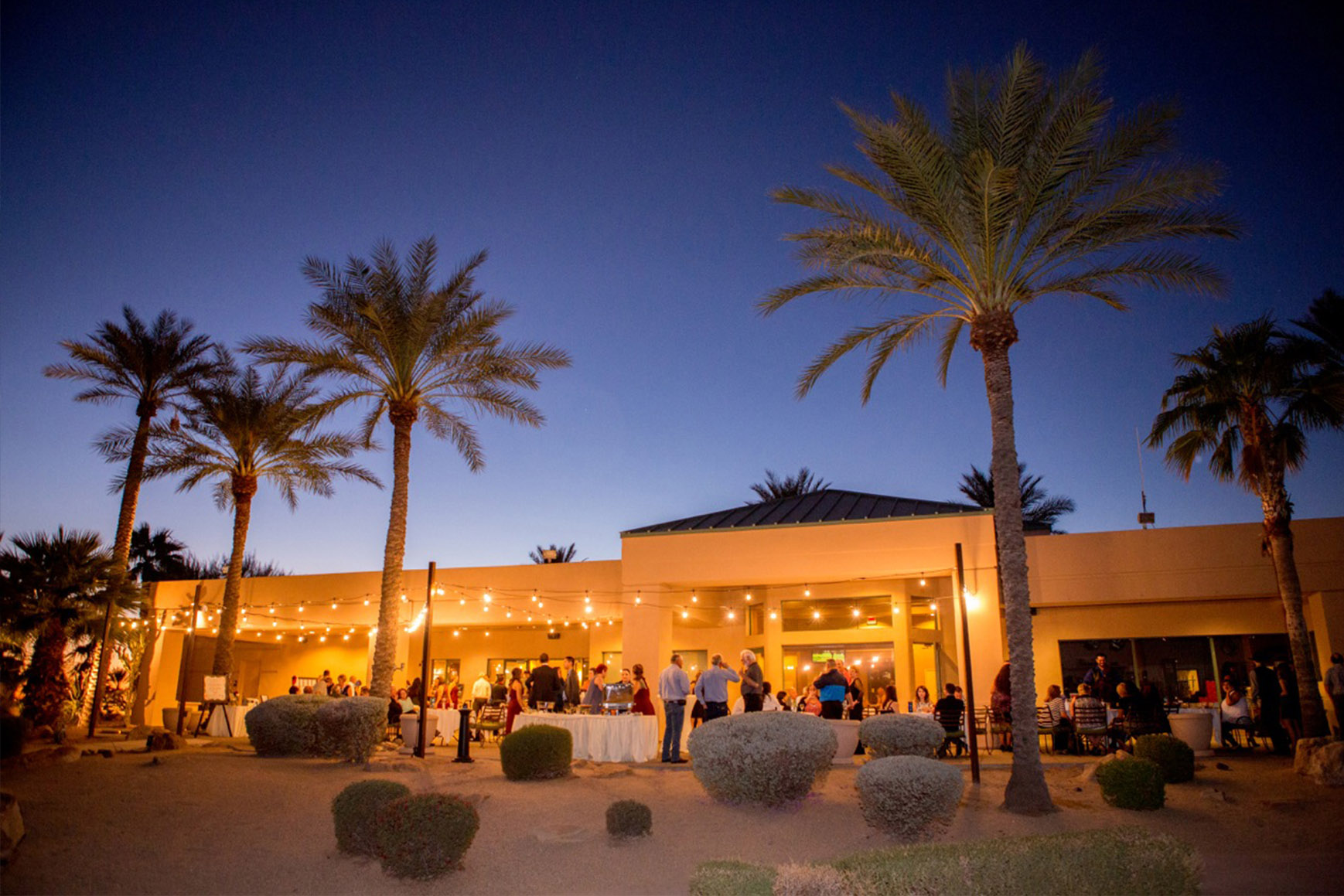 Building exterior with bistro lights - Palm Valley - Goodyear, Arizona - Maricopa County - Wedgewood Weddings