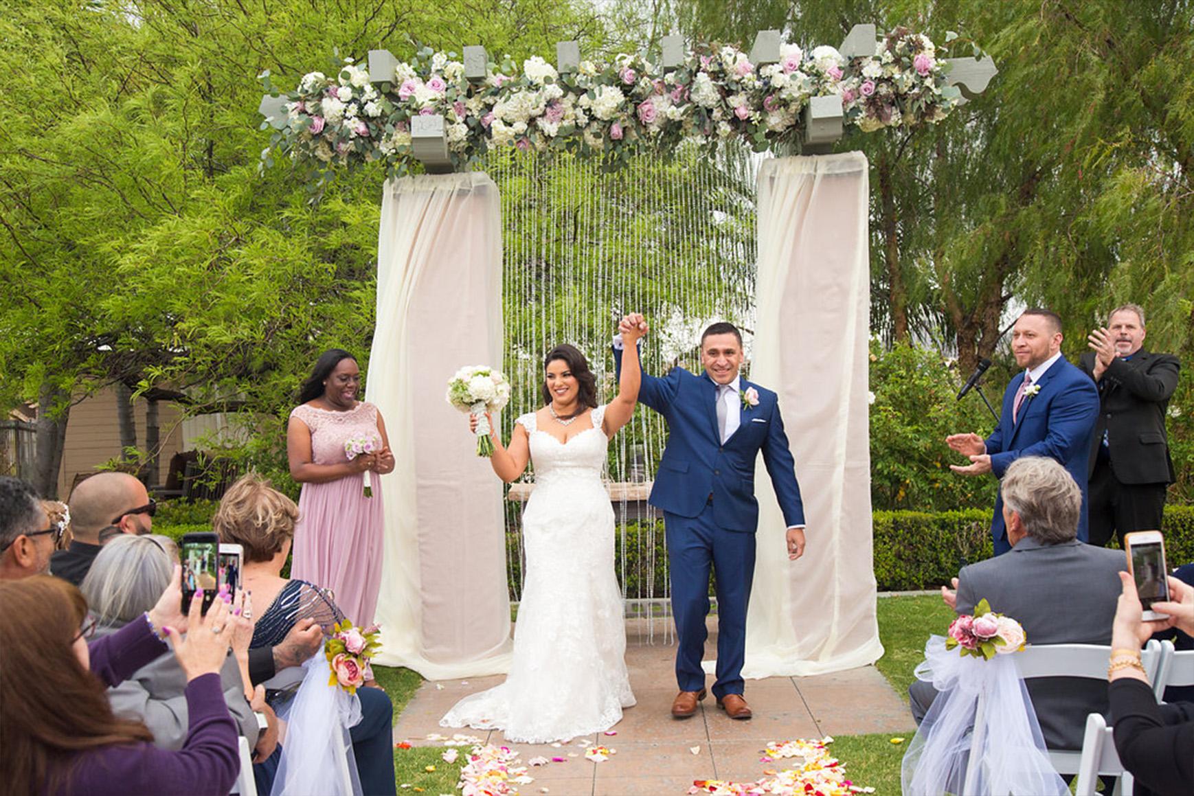 Newlyweds cheer - The Retreat - Corona, California - Riverside County - Wedgewood Weddings