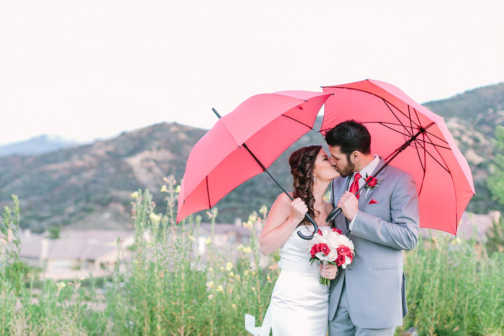 Pink umbrellas - The Retreat - Corona, California - Riverside County - Wedgewood Weddings