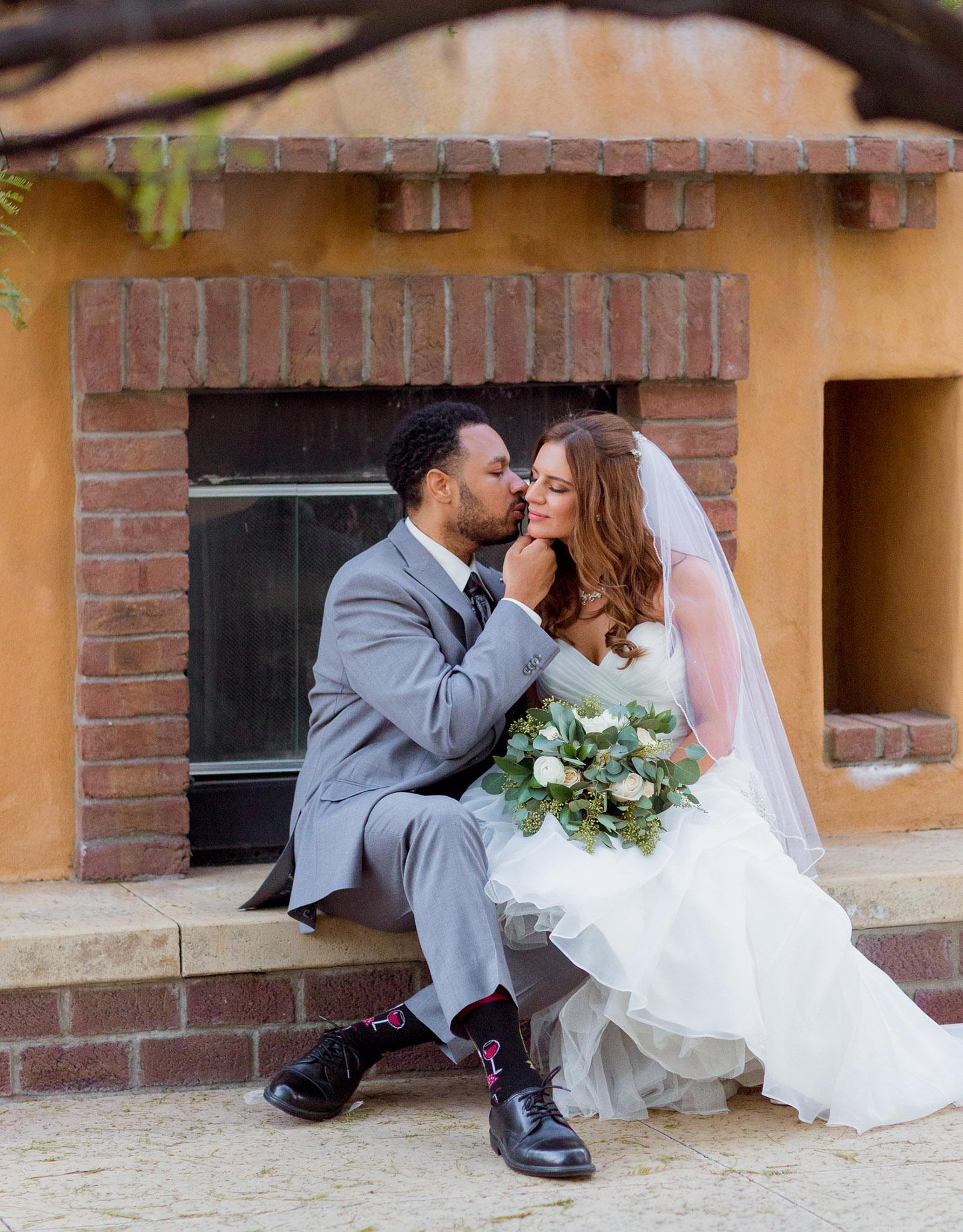 Bride & groom by fireplace - The Retreat - Corona, California - Riverside County - Wedgewood Weddings