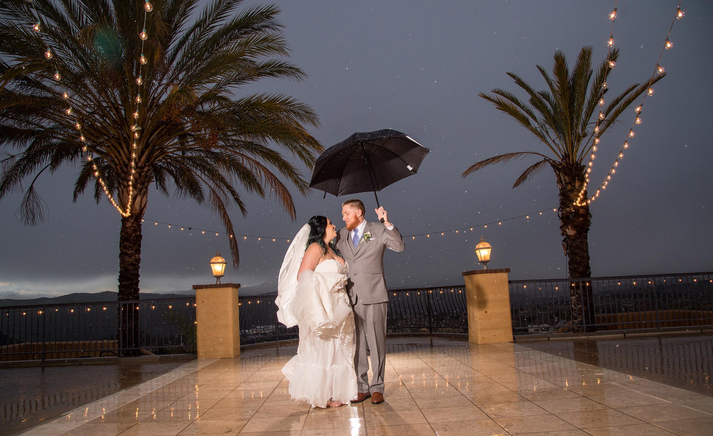 Dancing in the rain - The Retreat - Corona, California - Riverside County - Wedgewood Weddings