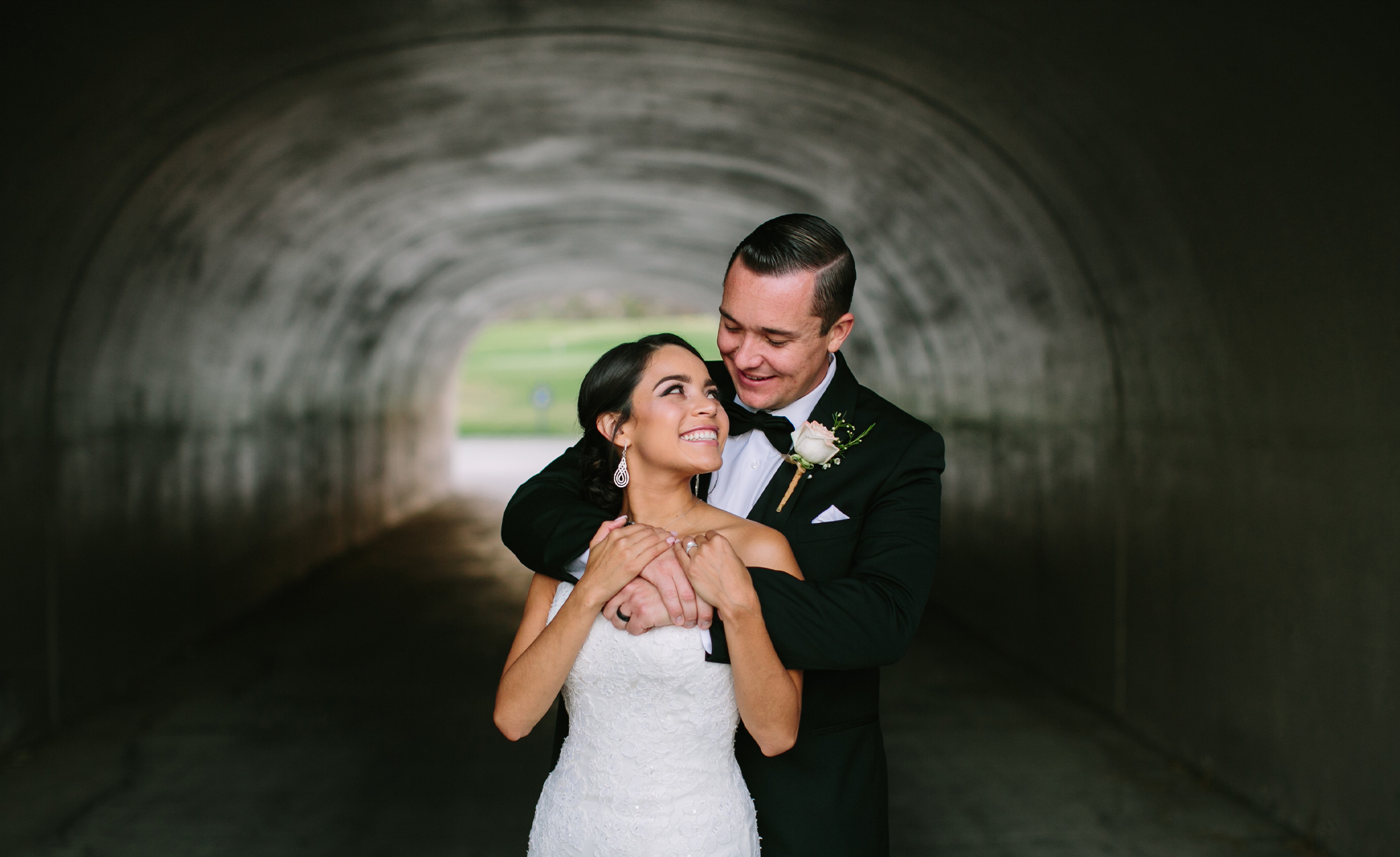 Bride & groom in the tunnel - The Retreat - Corona, California - Riverside County - Wedgewood Weddings