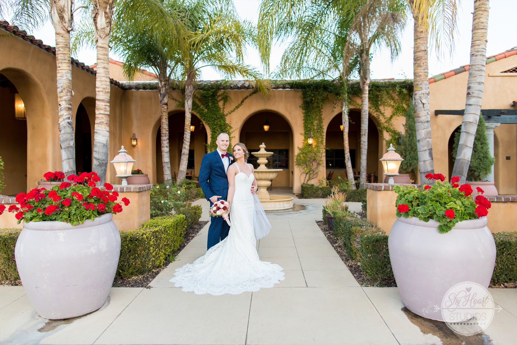 Bride & groom by fountain - The Retreat - Corona, California - Riverside County - Wedgewood Weddings