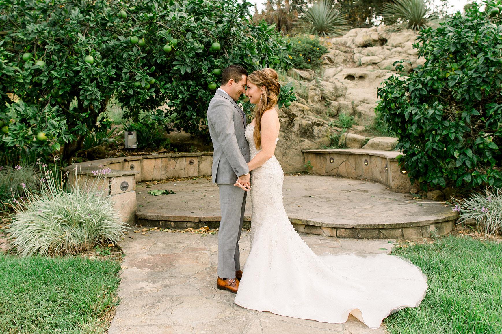Picturesque moment between a couple -  University Club - Irvine, California - Orange County - Wedgewood Weddings