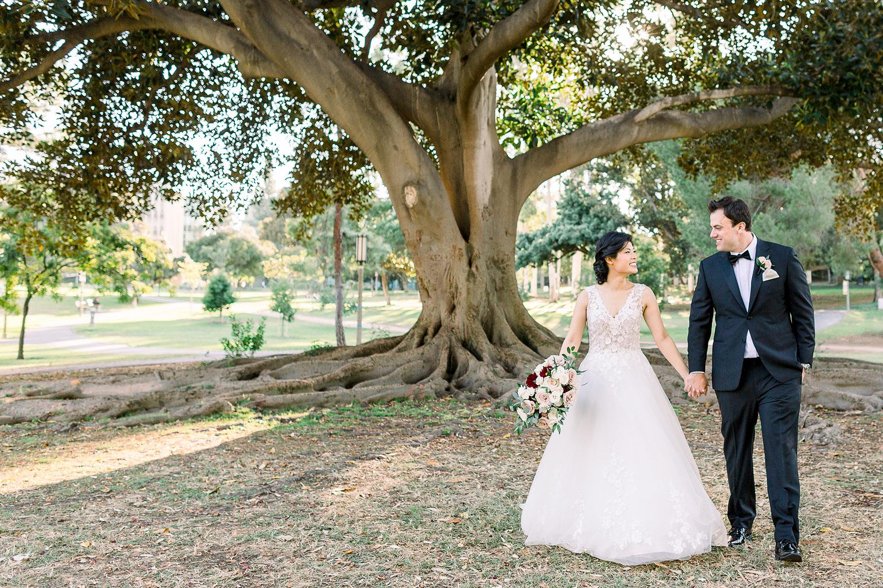 Couple walking through the beautiful grounds - University Club - Irvine, California - Orange County - Wedgewood Weddings