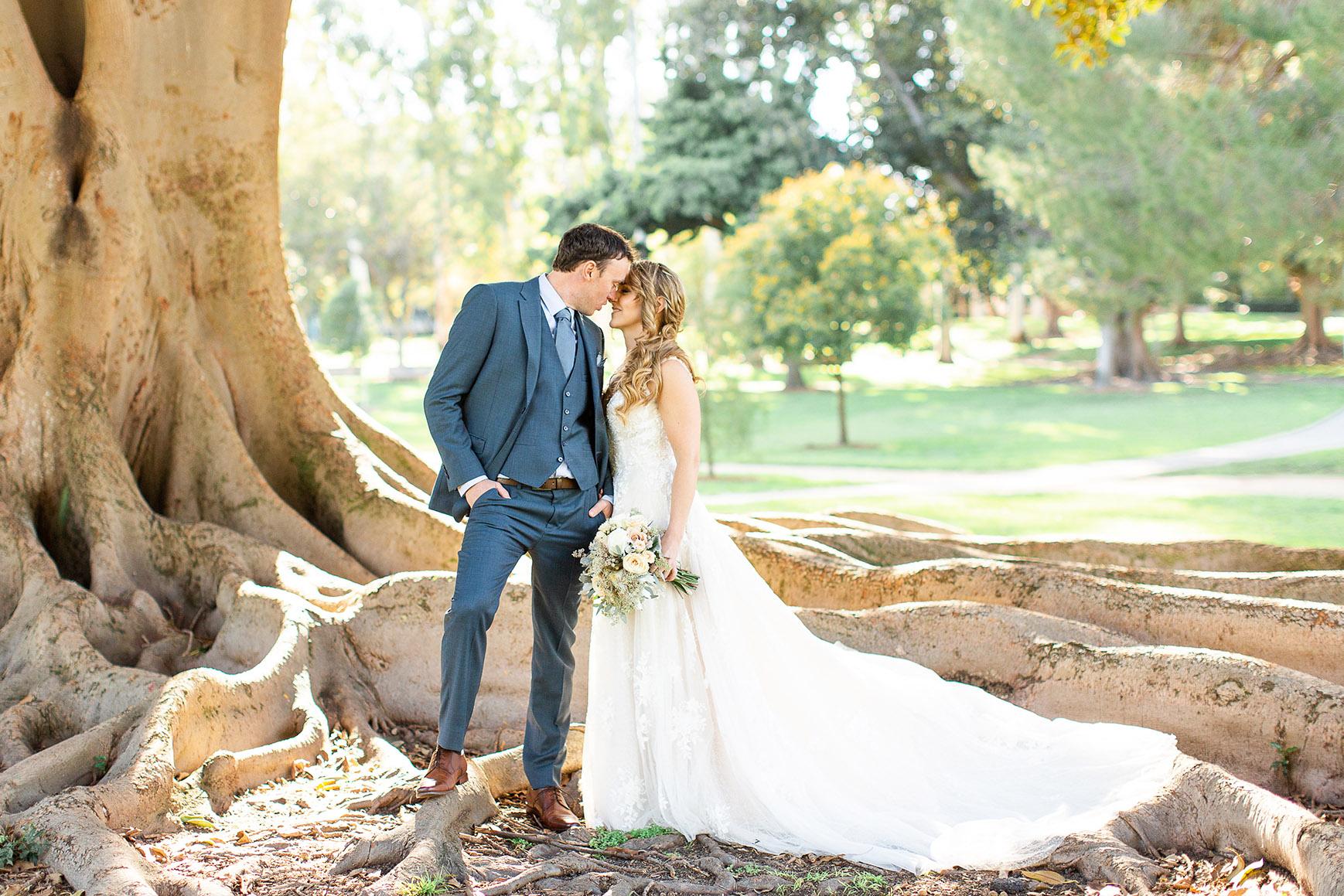 Bride and groom by a majestic tree - University Club - Irvine, California - Orange County - Wedgewood Weddings