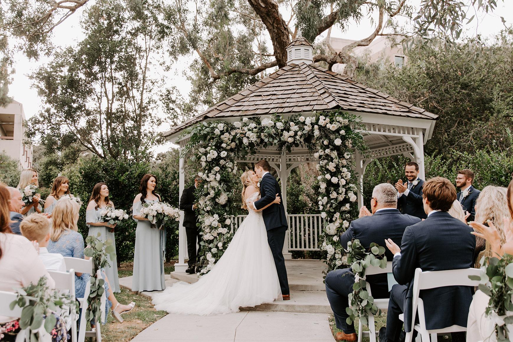 First kiss between bride and groom - University Club - Irvine, California - Orange County - Wedgewood Weddings