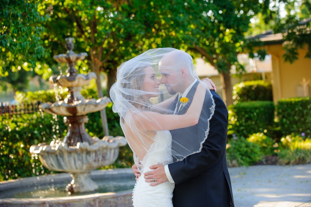 beautiful bride and groom together at brentwood wedding venue fountain