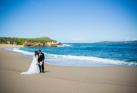 Romantic kiss on Monastery Beach - Carmel - Carmel, California - Monterey County - Wedgewood Weddings